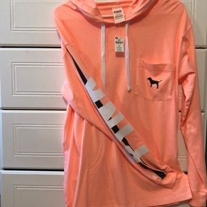 Pinkish orange longsleeve with hood and pocket